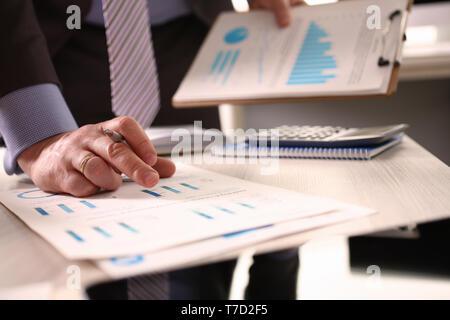 Accountant Calculate Tax Invoice Using Calculator - Stock Photo