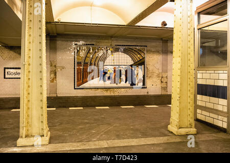 Klosterstraße U-Bahn underground railway station serves the U 2 line in Mitte, Berlin. Interior with tiled walls & pictures of historic buses & trains - Stock Photo