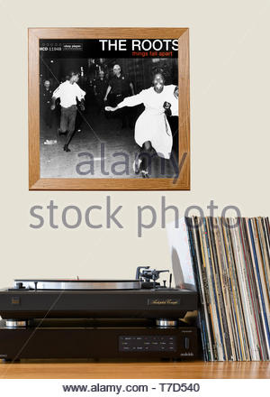 The Roots, Things Fall Apart album, Record player and framed album cover, England - Stock Photo