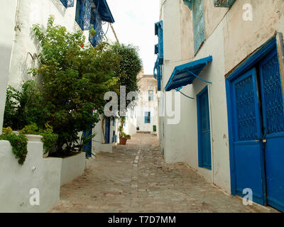 Streets, doors and buildings close to the center of Sidi Bou Said, the famous village with traditional Tunisian architecture - Stock Photo