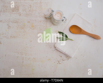 Homemade DIY vegan deodorant and ingredients following a plastic free and zero waste lifestyle, on a white background - Stock Photo