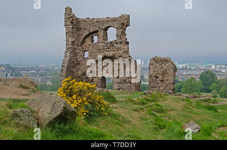 Saint Anthony's Chapel Ruins at Holyrood Park with view across Edinburgh, Scotland behind. - Stock Photo
