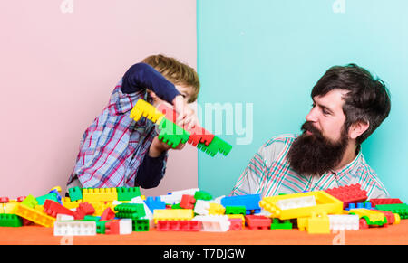 building plane with colorful constructor. happy family leisure. father and son play game. Dream about fly. love. child development. small boy with dad playing together. Having fun. plane fly. - Stock Photo