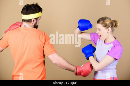 Defense wins championships. punching, sport Success. sportswear. Fight. Happy woman and bearded man workout in gym. training with coach. knockout and energy. couple training in boxing gloves. - Stock Photo