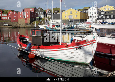 Torshavn, Faroe Islands. 7th May, 2019. Sunshine in Torshavn in the Faroe Islands, despite snowfall early this morning due to an Arctic Blast. The sunshine reflects off the yachts and boats moored in the harbour. Credit: Keith Larby/Alamy Live News - Stock Photo