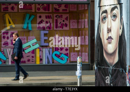 Manchester, UK. 7th May 2019. A new piece of street art has appeared in Stevenson Square in the Northern Quarter of Manchester, UK. The art work depicts the Game of Thrones character Arya Stark, played by actress Maisie Williams, and was created by artist Akse, the French-born street artist who has been living and working in Manchester since 1997. It's all part of outdoor public art project Outhouse MCR, which oversees the street art-rich part of the city centre. Credit: Paul Heyes/Alamy Live News - Stock Photo
