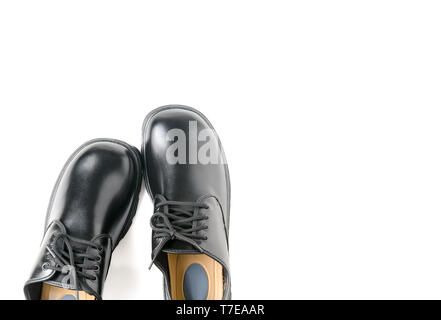 New leather student shoes isolated on white background, prepare for back to school concept and top view with copy space - Stock Photo