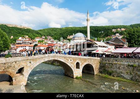 Stone bridge over Bistrica river, Sinan Pasha Mosque, Prizren, Kosovo - Stock Photo