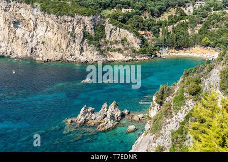 Ampelaki Bay, Paleokastritsa, beach resort, Corfu Island, Ionian Islands, Mediterranean Sea, Greece - Stock Photo
