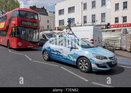 Google Street View car mapping the streets in London, on Whitechapel Road in the East End of London - Stock Photo