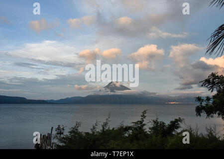 SCENIC VIEW OF VOLCANO AGAINST SKY DURING SUNRISE - Stock Photo