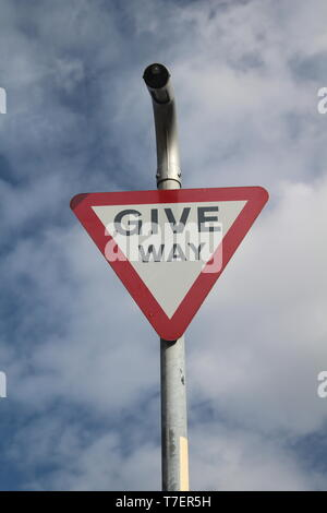 Give way sign on British road , Yorkshire England - Stock Photo
