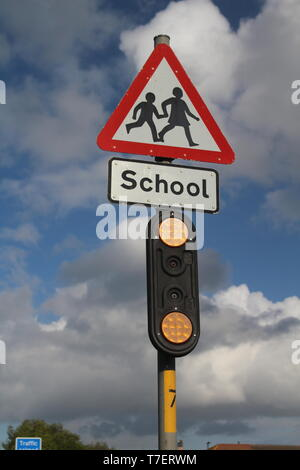 Road sign near British school crossing sign - Stock Photo