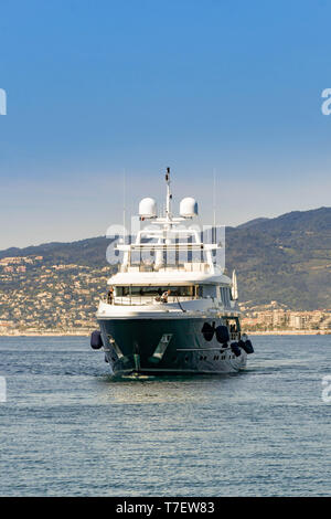 CANNES, FRANCE - APRIL 2019: Luxury motor yacht Clicia cruising in the bay in Cannes. - Stock Photo