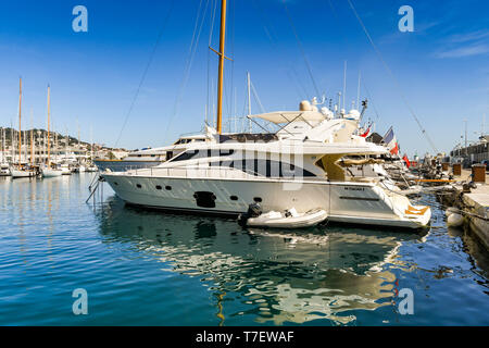 CANNES, FRANCE - APRIL 2019: Luxury motor yacht berthed in the Port Pierre Canto harbour in Cannes. - Stock Photo