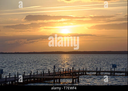 Sunset on the sea and Jetty. - Stock Photo