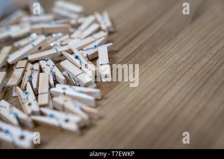 close up a lot of wooden new clips on the wood table. - Stock Photo