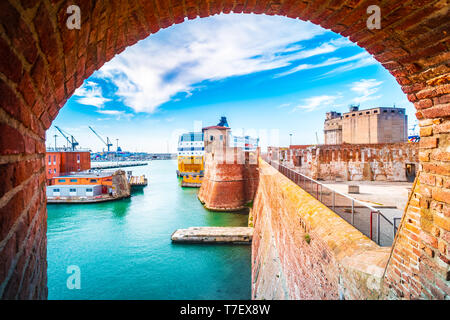 View of the landmark Fortezza Vecchia, an old fortress with a tower located in Livorno, a port city on the Ligurian Sea in Tuscany, Italy. - Stock Photo