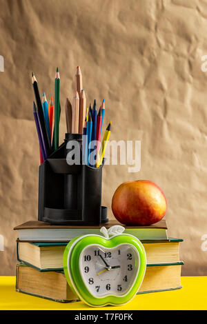 Back to school concept. Stack of books with school supplies. - Stock Photo