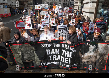 The London March Against Trophy Hunting and Extinction gathered at Cavendish Square and marched through Central London to Downing Street. - Stock Photo