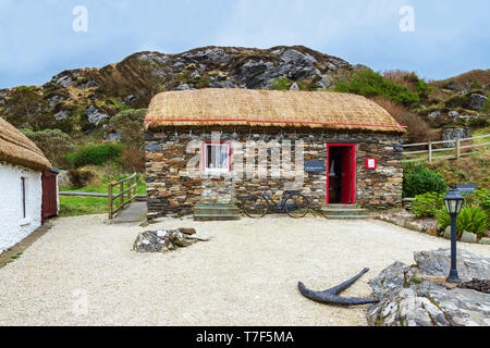 Tiny pub-grocer's at the Glencolmcille Folk Village, also known as Father McDyer's Folk Village Museum, Gleann Cholm Cille, County Donegal, Ireland. - Stock Photo