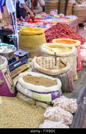 Sacks of spices and chillies on a stall in a local indoor market in Shahpura, a town in Dindori district of the central Indian state of Madhya Pradesh - Stock Photo