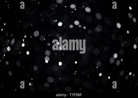 Real snowfall. Design pattern to overlay the image and create a snowfall effect. Deep black color. - Stock Photo