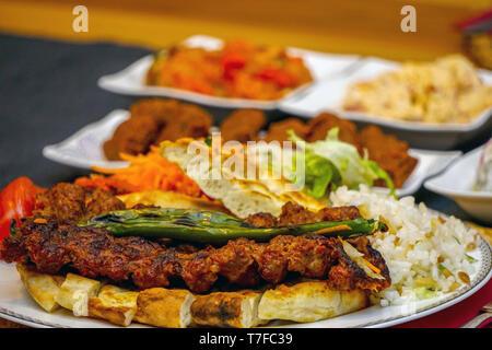 Turkish adana kebab with appetizers close up - Stock Photo