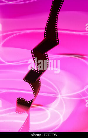 35mm film roll on isolated background - Stock Photo