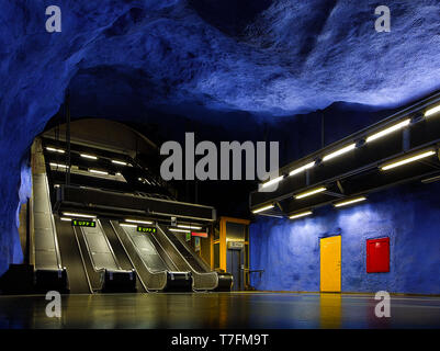 Blue rock interior subway station and empty escalators in Stockholm, Sweden - Stock Photo
