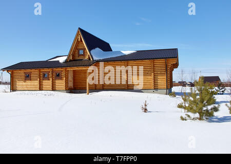 Wooden house at winter, sunny day - Stock Photo