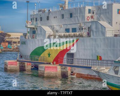 Dakar, Senegal - February 2, 2019: Big, white ship with senegalese flag in port of Dakar in Senegal. Africa. - Stock Photo