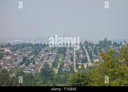 Vancouver, Canada. 9th July, 2015.  A haze of smog hangs over Metro Vancouver as a result of smoke from distant wild fires that has drifted into the area.  In this image downtown Vancouver is seen in the distance (looking West from Burnaby). - Stock Photo