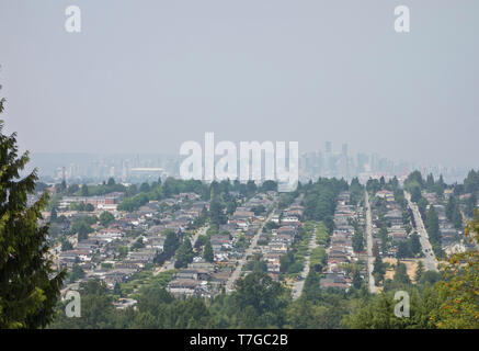 Vancouver, Canada. 9th July, 2015.  A haze of smog blankets Metro Vancouver as a result of smoke from distant wild fires that has drifted into the area.  In this image downtown Vancouver is seen in the distance (looking West from Burnaby).  Air quality advisories were issued. - Stock Photo
