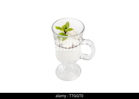 Ice cream dessert with whipped cream, isolated on a white background in a high transparent glass with chocolate sauce, topping, sprig, mint leaf. Dess - Stock Photo