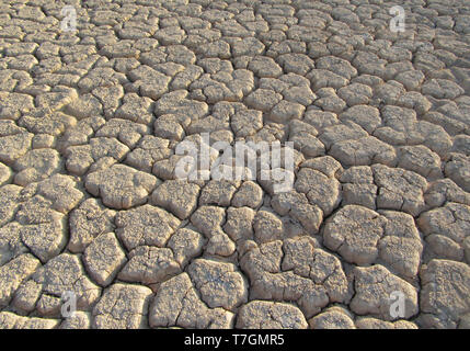 Dried out river bed (wadi) in Negev desert of Israel around the Dead Sea. - Stock Photo