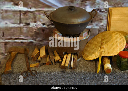 A demonstration set of rice cooking apparatus fuel by burning wood in ancient kitchen. - Stock Photo