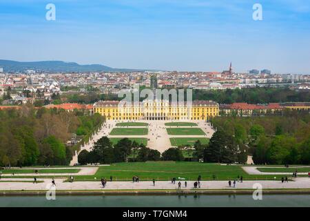 Garden Vienna, view of the parterre garden and baroque exterior of the south side of the Schloss Schönbrunn palace in Vienna, Austria. - Stock Photo