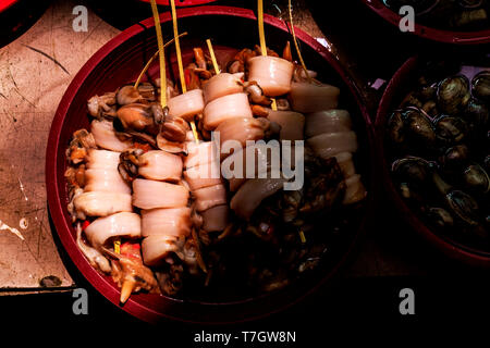 squid on skewer in  the fish market, Busan,South Korea - Stock Photo