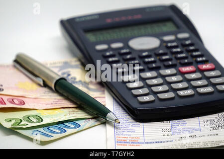 Turkish lira banknotes calculator bills and tax calculations on isolated background - Stock Photo