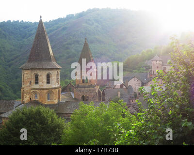 Conques, historic town along the Via Podiensis, also know as Le Puy Route, in southern France. Next to Abbey-Church of Saint-Foy. - Stock Photo