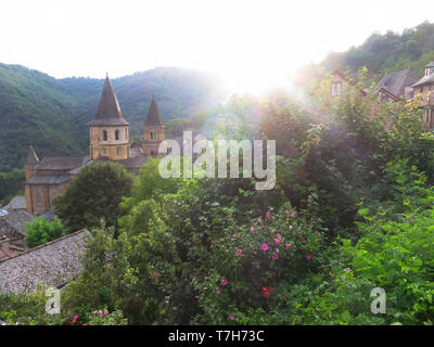 Conques, historic town along the Via Podiensis, also know as Le Puy Route, in southern France. - Stock Photo