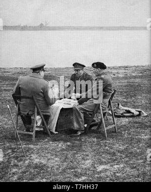 Winston Churchill, General Brooke and General Montgomery picnic on the banks of the Rhine 26th March 1945 - Stock Photo