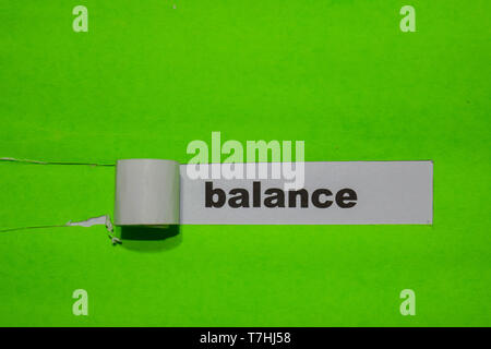 Balance, Inspiration and business concept on green torn paper - Stock Photo