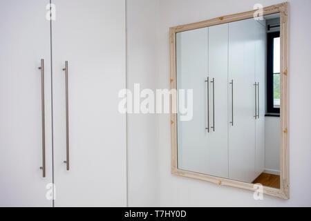Mirror in white closet room, wardrobe modern design, white and clean - Stock Photo