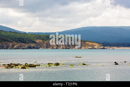 Mountains and sea. Scenic seascape. Place where the Ropotama river flows into the sea. Bulgarian Black Sea coast. Selective focus. - Stock Photo