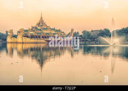 Kandawgyi lake in Yangon city with the famous Karaweik palace - Stock Photo
