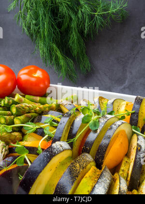Ratatouille - traditional French Provencal vegetable dish cooked in oven, vegetarian food, health food concept - Stock Photo