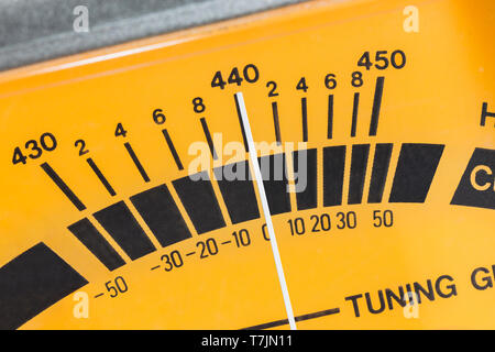 Macro close up detail of calibration meter on old guitar tuner. - Stock Photo