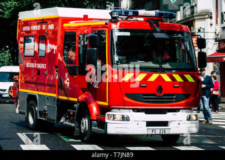 Paris France May 04, 2019 View of a French fire engine rolling in the street during protests of the Yellow jackets against the policy of President Mac - Stock Photo